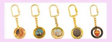 wholesale gift from china manufatrurer -assorted desing in gold color keychain